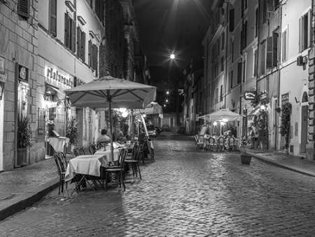 Sidewalk cafe on narrow streets of Rome, Italy poster print by Assaf Frank