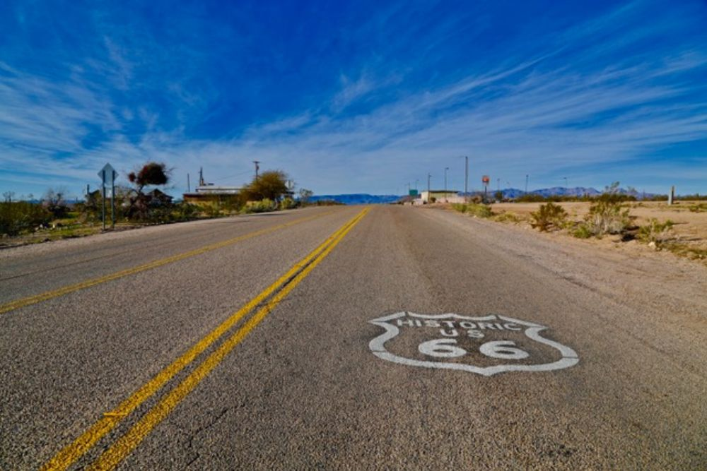 Route 66 With Clouds poster print by Susan Vizvary