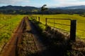 Farm track and gate in green landscape. poster print by Johnny Haglund